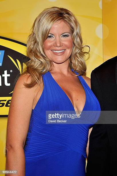 Eva Busch the wife of driver Kurt Busch poses on the red carpet for the NASCAR Sprint Cup Series awards banquet during the final day of the NASCAR...