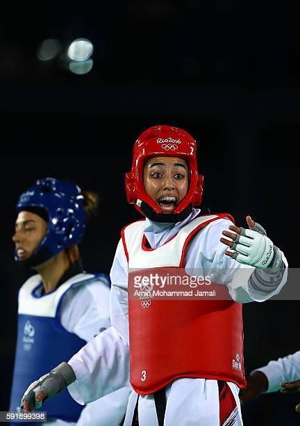 AUGUST 18 Eva Calvo Gomez of Spain in action against Kimia Alizadeh Zenoorin of Iran during the Women's Taekwondo 57kg quarter finals at the Carioca...