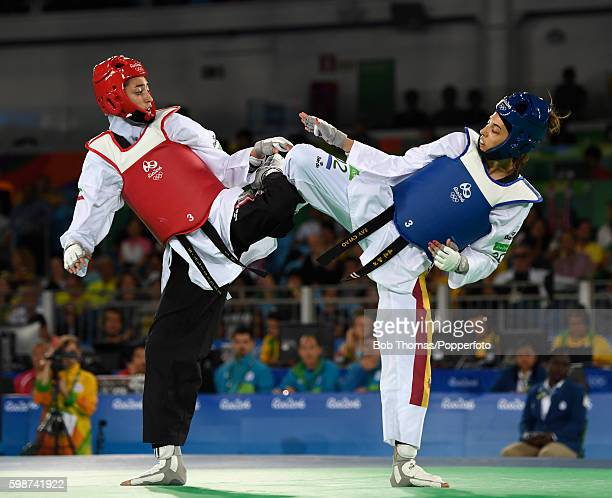 Eva Calvo Gomez of Spain in action against Kimia Alizadeh Zenoorin of Iran during the Women's Taekwondo 57kg quarter finals at the Carioca Arena on...