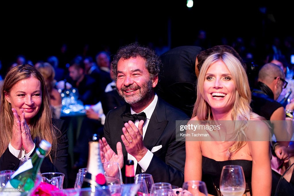 Eva Cavalli, Remo Ruffini and Heidi Klum attend the amfAR Milano 2014 - Gala Dinner and Auction as part of Milan Fashion Week Womenswear Spring/Summer 2015 on September 20, 2014 in Milan, Italy.