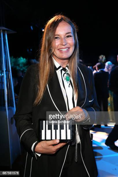 Eva Cavalli with a piano bag during the DeGrisogono 'Love On The Rocks' gala during the 70th annual Cannes Film Festival at Hotel du CapEdenRoc on...