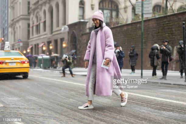 Eva Chen is seen on the street during New York Fashion Week AW19 wearing pastel purple wool coat and beanie on February 12 2019 in New York City