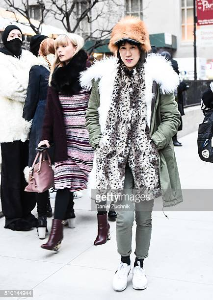 Eva Chen is seen outside the Alexander Wang show wearing a green and white fur parka with a brown fur hat during New York Fashion Week Women's...