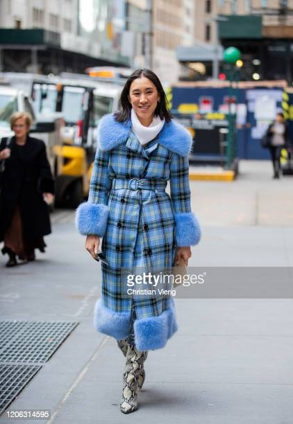 Eva Chen is seen weairng blue belted checkered coat with faux fur collar and sleeves outside Michael Kors during New York Fashion Week Fall / Winter...