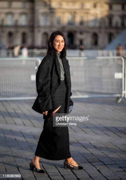Eva Chen is seen wearing black skirt with slit blazer jacket outside Louis Vuitton during Paris Fashion Week Womenswear Fall/Winter 2019/2020 on...