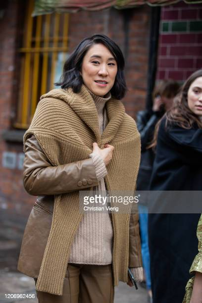 Eva Chen is seen wearing brown knit, pants outside JW Anderson during London Fashion Week February 2020 on February 17, 2020 in London, England.