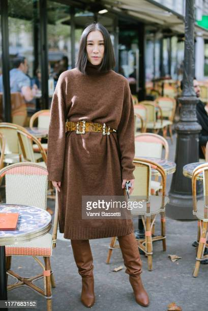 Eva Chen poses wearing a Rejina Pyo belt and Frame boots after the Altuzarra show at the Hotel Potocki during Paris Fashion Week Womenswear Spring...
