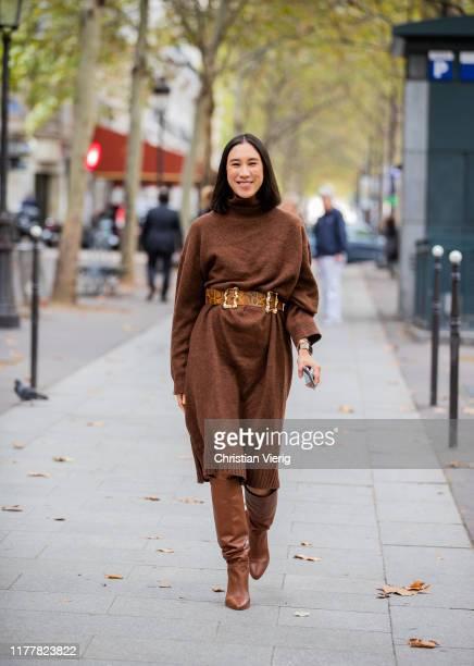Eva Chen seen wearing brown knited dress, belt with snake print, boots outside Altuzarra during Paris Fashion Week Womenswear Spring Summer 2020 on...