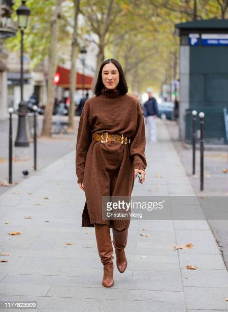 Eva Chen seen wearing brown knited dress belt with snake print boots outside Altuzarra during Paris Fashion Week Womenswear Spring Summer 2020 on...