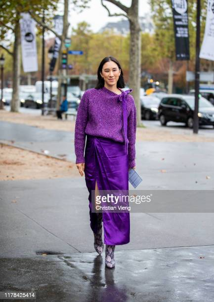 Eva Chen seen wearing purple knit, silk skirt with slit, boots with snake print outside Chanel during Paris Fashion Week Womenswear Spring Summer...