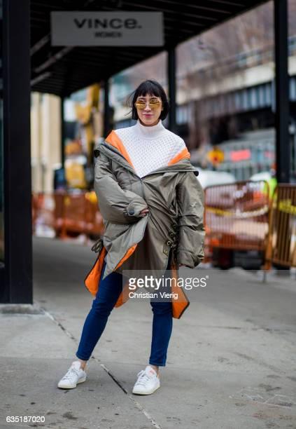 Eva Chen wearing a parka knit denim jeans outside Carolina Herrera on February 13 2017 in New York City