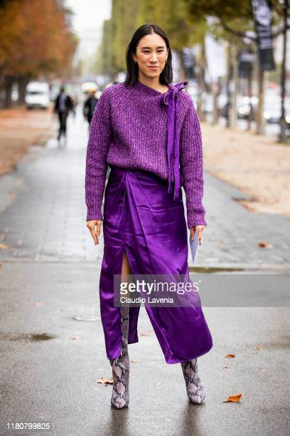 Eva Chen, wearing a purple sweater, purple skirt and snake print boots, is seen outside the Chanel show during Paris Fashion Week - Womenswear Spring...