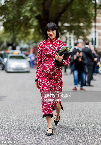 Eva Chen wearing a red dress and pointed flats outside Christopher Kane during London Fashion Week Spring/Summer collections 2017 on September 19...