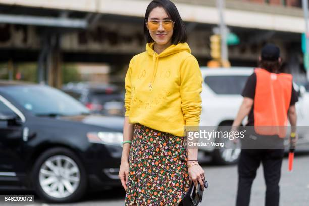 Eva Chen wearing a yellow hoody seen in the streets of Manhattan outside Coach during New York Fashion Week on September 12, 2017 in New York City.