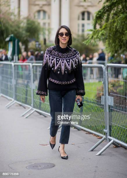Eva Chen wearing black knit seen outside Sacai during Paris Fashion Week Spring/Summer 2018 on October 2 2017 in Paris France