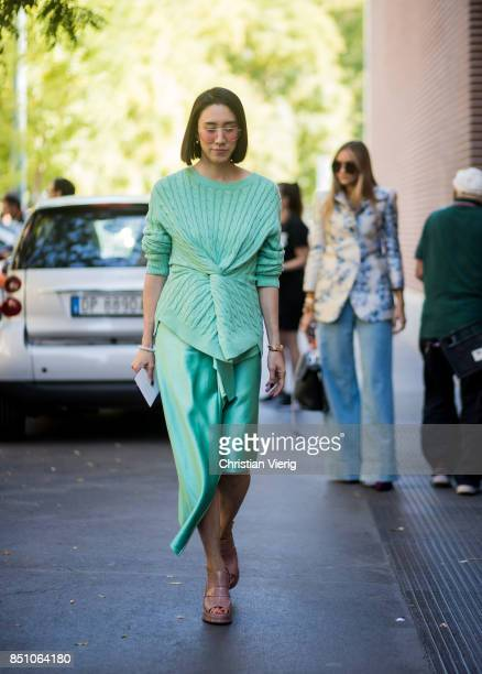 Eva Chen wearing green knit and skirt is seen outside Fendi during Milan Fashion Week Spring/Summer 2018 on September 21 2017 in Milan Italy