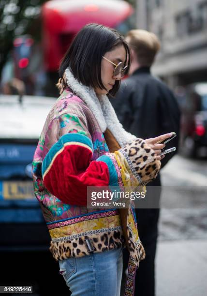 Eva Chen wearing jacket, denim jeans outside Erdem during London Fashion Week September 2017 on September 18, 2017 in London, England.
