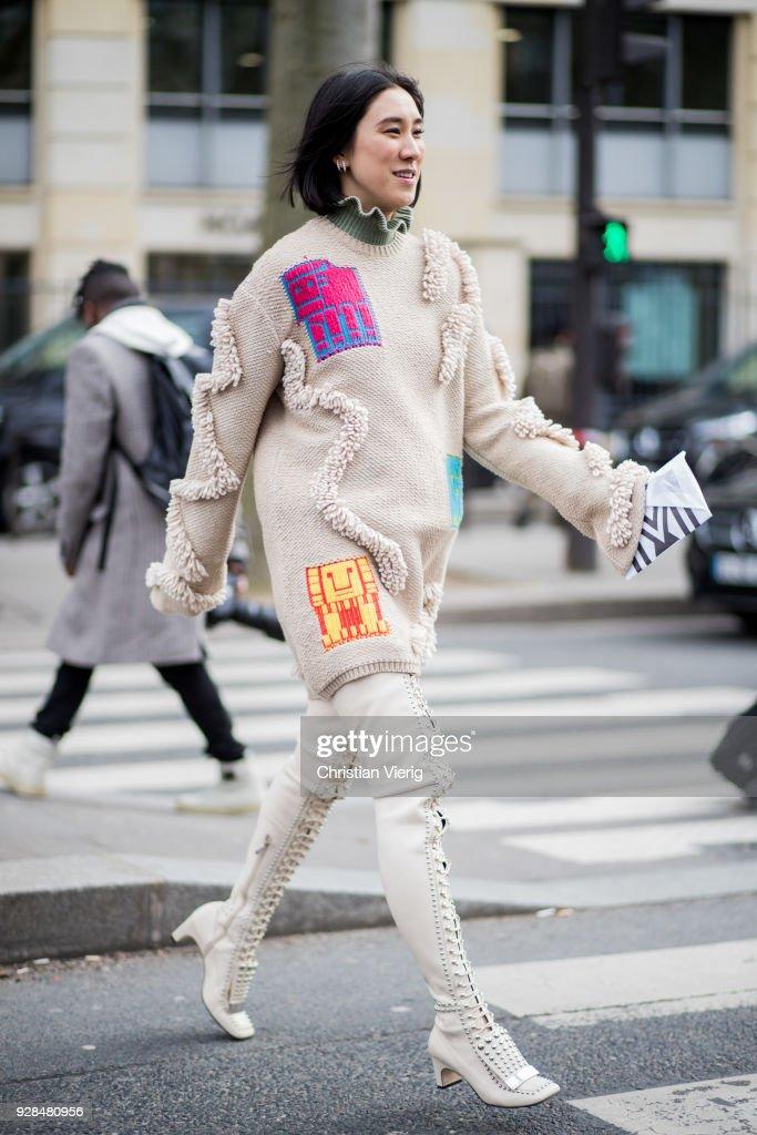 Eva Chen wearing knit, laced overknee boots is seen outside Miu Miu during Paris Fashion Week Womenswear Fall/Winter 2018/2019 on March 6, 2018 in Paris, France.