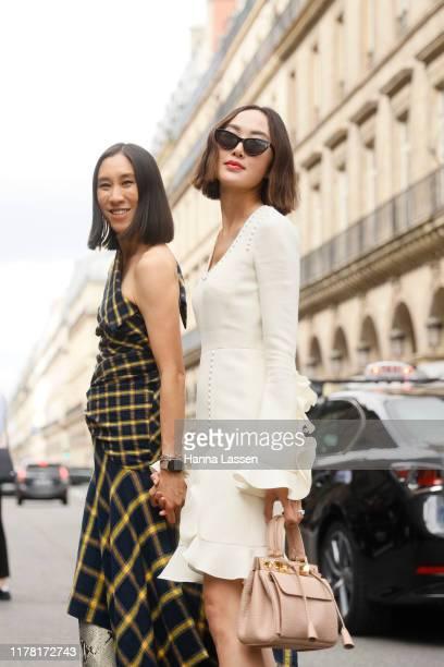 Eva Chen wearing Monse dressParis Texas boots and Chriselle Lim wearing white mini dress outside Giambattista Valli during Paris Fashion Week...