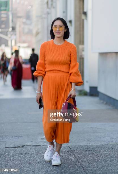 Eva Chen wearing orange knit and skirt seen in the streets of Manhattan outside Michael Kors during New York Fashion Week on September 13, 2017 in...