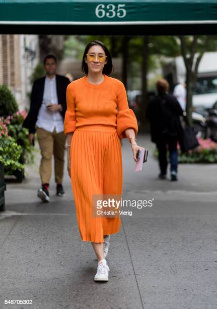 Eva Chen wearing orange knit and skirt seen in the streets of Manhattan outside Marc Jacobs during New York Fashion Week on September 13, 2017 in New...