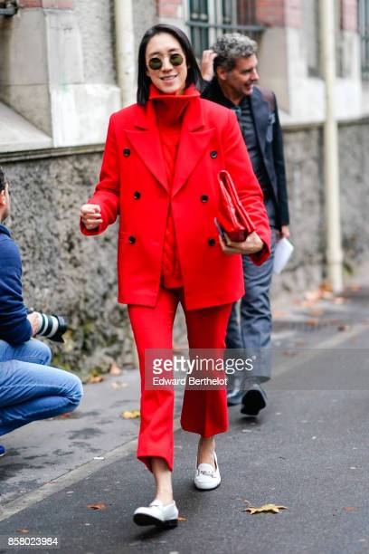 Eva Chen wears a red jacket a red turtleneck red flare cropped pants white shoes outside Valentino during Paris Fashion Week Womenswear Spring/Summer...