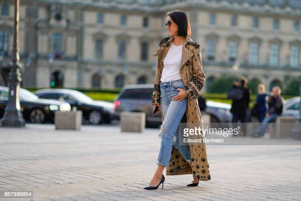 Eva Chen wears a Vuitton coat a white top blue jeans outside Louis Vuitton during Paris Fashion Week Womenswear Spring/Summer 2018 on October 3 2017...