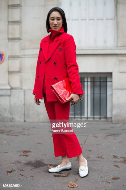 Eva Cheng poses after the Valentino show at the Lycee Carnot during Paris Fashion week Womenswear SS18 on October 1 2017 in Paris France
