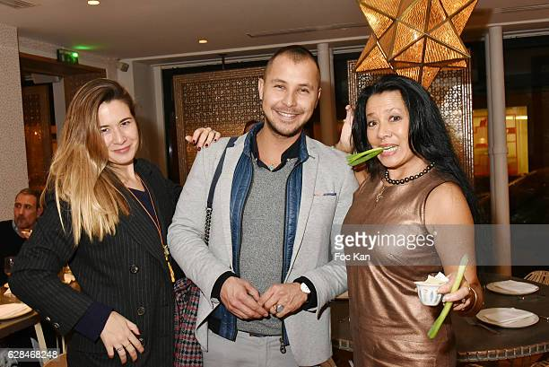Eva Connolly and painters David Stephane Barneville and Chloe Eriau attend Liza Liwan Exhibition Cocktail at Liza Restaurant on December 7 2016 in...