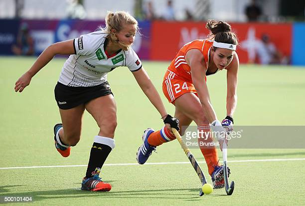 Eva de Goede of the Netherlands is tackled by Anissa Korth of Germany during the Hockey World League Final Pool A match between the Netherlands and...