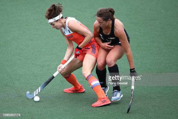 Eva de Goede of the Netherlands under pressure from Olivia Shannon of New Zealand during the Women's FIH Field Hockey Pro League match between New...