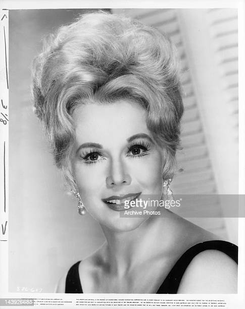 Eva Gabor smiling in a scene from the film 'Youngblood Hawke' 1964