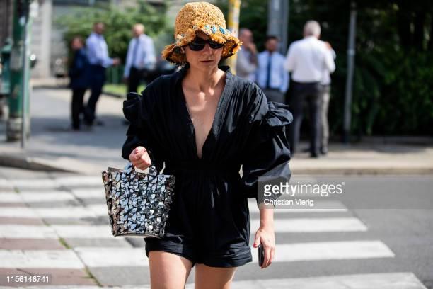 Eva Geraldine Fontanelli is seen wearing bucket hat black dress silver bag outside M1992 during the Milan Men's Fashion Week Spring/Summer 2020 on...