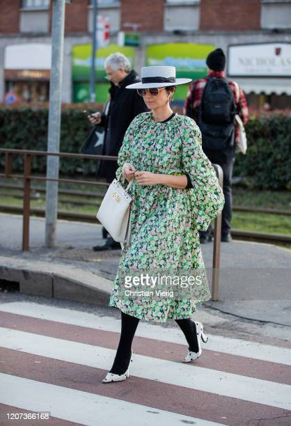 Eva Geraldine Fontanelli is seen wearing dress with floral print, white hat outside Gucci during Milan Fashion Week Fall/Winter 2020-2021 on February...
