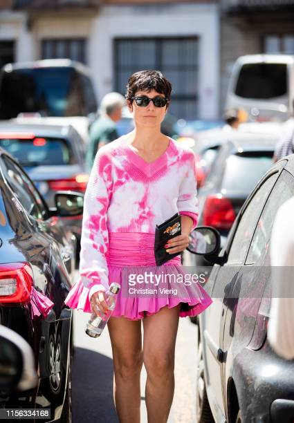 Eva Geralidine Fontanelli is seen wearing pink skirt v neck jumper with print outside Etro during the Milan Men's Fashion Week Spring/Summer 2020 on...