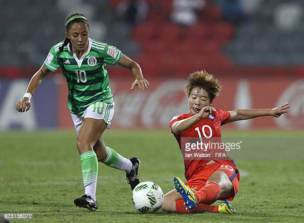 Eva Gonzalez of Mexico is tackled by Jang Chang of Korea Republic during the FIFA U20 Women's World Cup Group D match between Mexico and Korea...