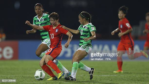 Eva Gonzalez of Mexico tries to tackle Jang Chang of Korea Republic during the FIFA U20 Women's World Cup Group D match between Mexico and Korea...