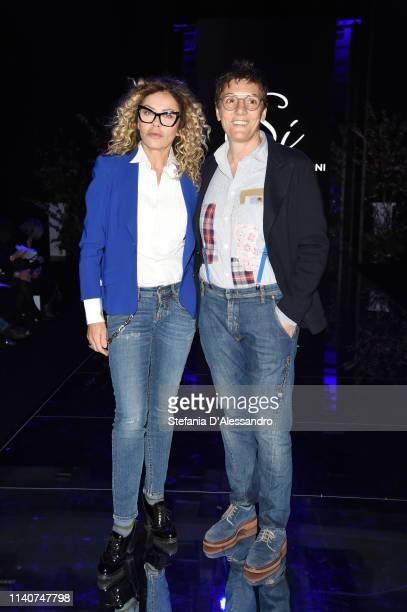 Eva Grimaldi and Imma Battaglia attend the Enzo Miccio show at Sposaitalia Collezioni on April 06 2019 in Milan Italy