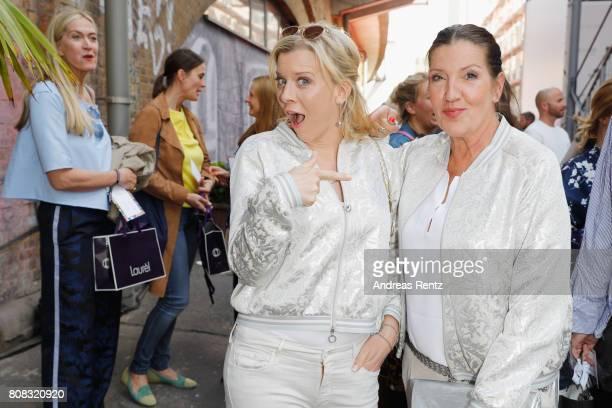 Eva Habermann and Katy Karrenbauer attend the Riani Fashion Show Spring/Summer 2018 at Umspannwerk Kreuzberg on July 4 2017 in Berlin Germany