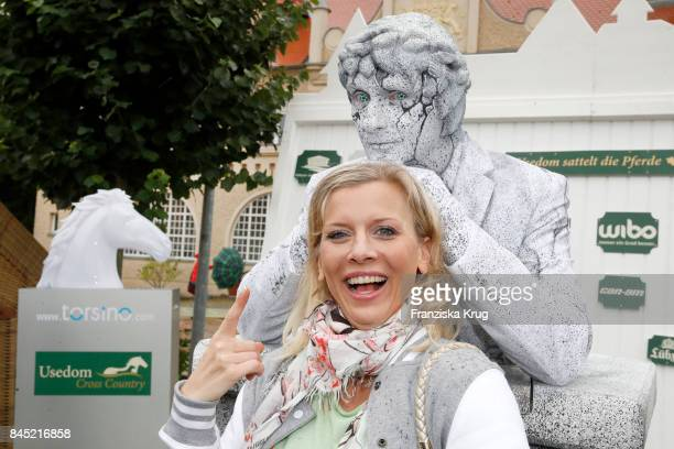 Eva Habermann and Living Doll Perfomer JOHNman attends the Till Demtroeders CharityEvent 'Usedom Cross Country' at Schloss Stolpe on September 9 2017...