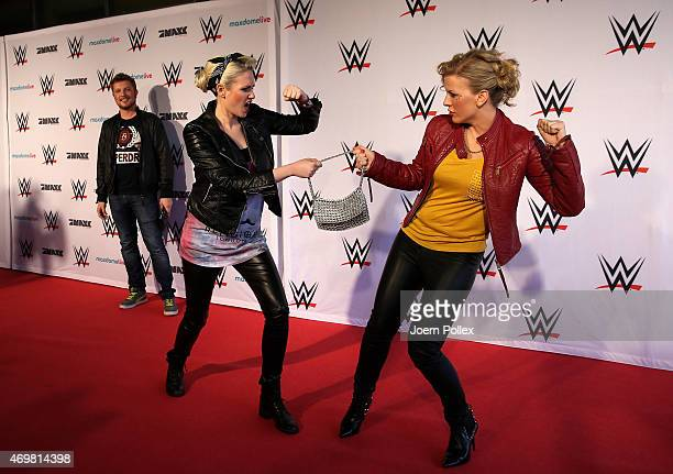 Eva Habermann and Sarah Knappik pictured on the red carpet prior to the WWE Live event at O2 World on April 15 2015 in Hamburg Germany
