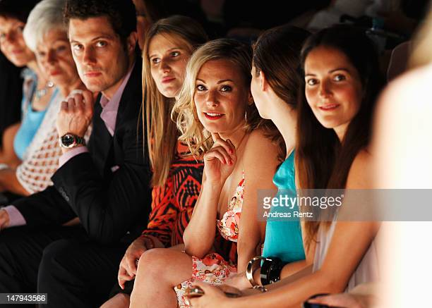 Eva Hassmann sits in the fron row for the Kilian Kerner show during the Mercedes-Benz Fashion Week Spring/Summer 2013 on July 6, 2012 in Berlin,...