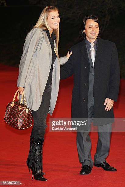 Eva Henger and Massimiliano Caroletti attend a premiere for 'Into The Wild' during day 7 of the 2nd Rome Film Festival on October 24, 2007 in Rome,...