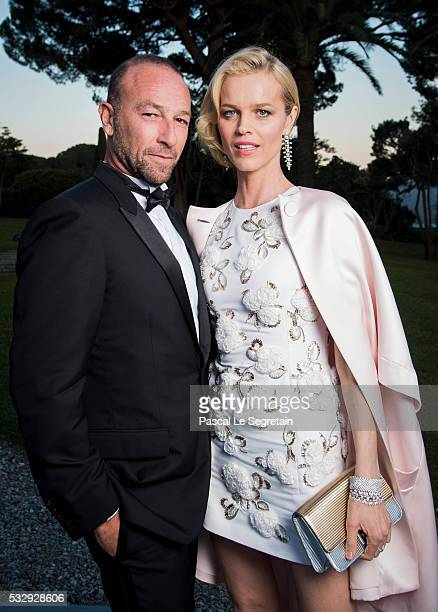 Eva Herzigova and a guest pose for photographs at the amfAR's 23rd Cinema Against AIDS Gala at Hotel du CapEdenRoc on May 19 2016 in Cap d'Antibes...