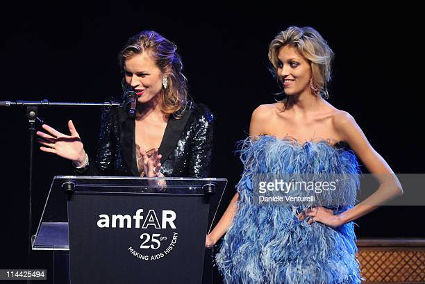 Eva Herzigova and Anja Rubik onstage at amfAR's Cinema Against AIDS Gala during the 64th Annual Cannes Film Festival at Hotel Du Cap on May 19 2011...