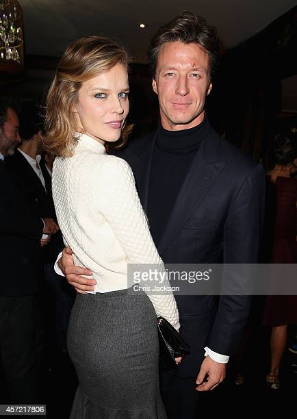 Eva Herzigova and Gregorio Marsiaj attend a dinner at China Tang after Moncler hosted the 'Monuments' Exhibition with Leica on October 14 2014 in...