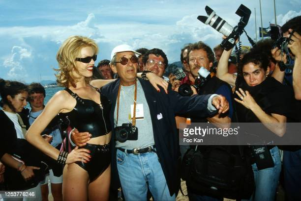 Eva Herzigova and Helmut Newton attend the 49th Cannes film Festival in May 1996, in Cannes, France.