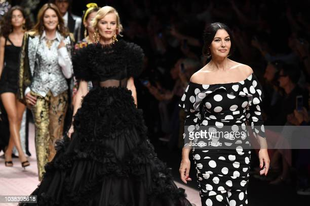 Eva Herzigova and Monica Bellucci walk the runway at the Dolce Gabbana show during Milan Fashion Week Spring/Summer 2019 on September 23 2018 in...