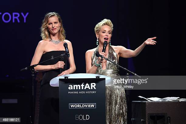 Eva Herzigova and Sharon Stone speak onstage during amfAR's 21st Cinema Against AIDS Gala Presented By WORLDVIEW BOLD FILMS And BVLGARI at Hotel du...