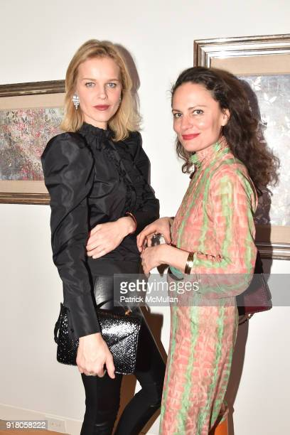 Eva Herzigova and Yelena Yemchuk attend Neil Grayson Industrial Melanism solo exhibition at Eykyn Maclean Gallery on February 13 2018 in New York City